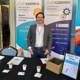 Jonathan Sherwin standing at the Bathcomms stand at the Bath Business Expo